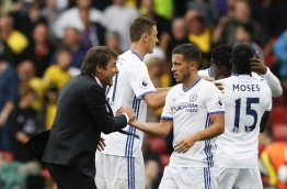 Chelsea's Italian head coach Antonio Conte (L) shakes hands with Chelsea's Belgian midfielder Eden Hazard (C) after the final whistle in the English Premier League football match between Watford and Chelsea at Vicarage Road Stadium in Watford, north of London on August 20, 2016. / AFP PHOTO / Ian Kington / RESTRICTED TO EDITORIAL USE. No use with unauthorized audio, video, data, fixture lists, club/league logos or 'live' services. Online in-match use limited to 75 images, no video emulation. No use in betting, games or single club/league/player publications. /