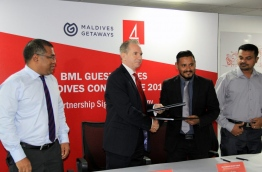 Bank of Maldives Ltd (BML) and the conference's organizer Maldives Getaways signing the agreement late Thursday. PHOTO/BML