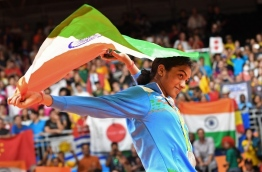 Silver medalist India's Pusarla V. Sindhu celebrates on the podium following the women's singles Gold Medal badminton match at the Riocentro stadium in Rio de Janeiro on August 19, 2016, for the Rio 2016 Olympic Games. / AFP PHOTO / GOH Chai Hin