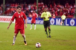 Former Argentina captainAyala plays the ball during the exhibition match between the Maldives' 2008 championship winning team and the current national team at the Maldives National Football Stadium on August 29, 2016. MIHAARU PHOTO/NISHAN ALI