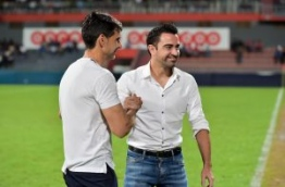 Ayala and Xavi pictured before kickoff of the exhibition match between the Maldives' 2008 championship winning team and the current national team at the Maldives National Football Stadium on August 29, 2016. MIHAARU PHOTO/NISHAN ALI