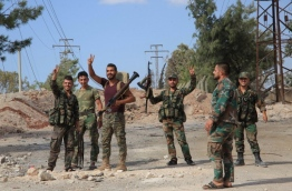 Syrian government troops seized a military academy south of Aleppo city, once again encircling the rebel-held districts in the east and placing them under siege, a monitor said. Government forces had been advancing in southern Aleppo for days, with the fighting already creating shortages for the estimated 250,000 people living in the rebel-held parts of the city. But the capture of the academies, which straddle the road running to the eastern neighbourhoods, reinstates the government's encirclement of Aleppo. / AFP PHOTO / GEORGE OURFALIAN
