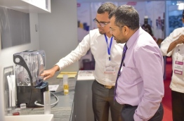 Tourism minister Moosa Zameer visits a stall at the Hotel Asia Exhibition 2016. PHOTO: MOHAMED SHARUHAAN/MIHAARU