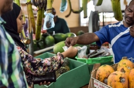 Woman making a purchase at the local market in capital Male. FILE PHOTO: NISHAN ALI/MIHAARU