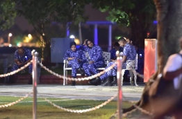 Some police officers taking a break during a opposition protest held in the capital Male late last month. MIHAARU FILE PHOTO/MOHAMED SHARUHAAN