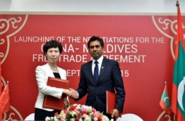 Economic minister Mohamed Saeed (R) signs agreement with China at the launching of the free trade negotiations between the Maldives and China on September 8, 2015.