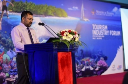 Tourism minister Moosa Zameer speaks at the Tourism Industry Forum. PHOTO: HUSSAIN SHAYAAH/MIHAARU