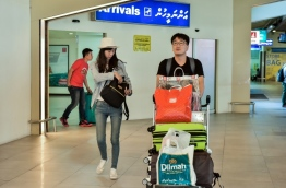 Chinese tourists pictured at Ibrahim Nasir International Airport. PHOTO: NISHAN ALI/MIHAARU