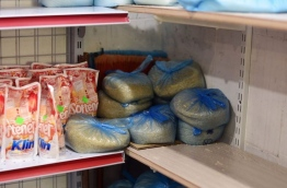 Bags of rice stocked up on a shelf at a retail outlet in the capital Male. MIHAARU PHOTO/HUSSAIN SHAYAAH