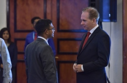 Finance minister Ahmed Munawar (L) speaks with Bank of Maldives Ltd (BML) CEO Andrew Healy. FILE PHOTO: NISHAN ALI/MIHARU