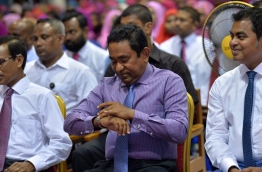 President Yameen checks his watch during the ceremony held in Fuvahmulah city to inaugurate a new water and sewerage system project on Tuesday. PHOTO/PRESIDENT'S OFFICE