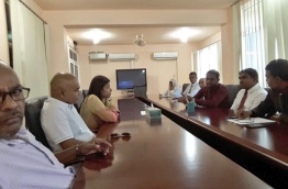 Election commission members meeting top MDP officials.