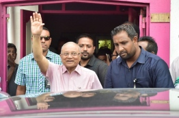 Gayoom waves at the crowd gathered outside the PPM office after he ignored a court order to handover party control to hold a council sit-down last Thursday. MIHAARU PHOTO/MOHAMED SHARUHAAN