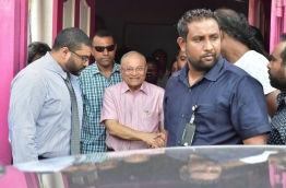 PPM leader Gayoom's son, Ghassan (L) looks on as his father (C) exits the party office after a press conference on Sunday. MIHAARU PHOTO/MOHAMED SHARUHAAN
