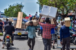 Unloading goods at the local market in capital Male. FILE PHOTO: NISHAN ALI/MIHAARU