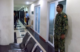 MNDF Soldier guarding the Main Office of MMPRC at the time of Corruption