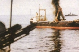 MV Progress Light, commandeered by Sri Lankan mercenaries during the coup on November 3, 1988, smokes after the attack by Indian frigate INS Godavari.