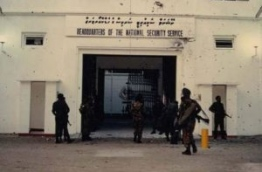 Soldiers of the Maldivian and Indian military overseeing the security outside NSS headquarters, riddled with bullet holes, following the Sri Lankan mercenaries' escape after the coup on November 3, 1988.