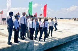 Housing Minister Dr Mohamed Muizzu and Environment Minister Thoriq Ibrahim take a tour of the reclaimed land allocated for waste management in capital Male's Industrial Village. PHOTO/ENVIRONMENT MINISTRY