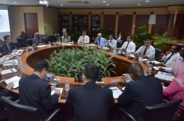 Maldives' ministers and top executives of four international banks meet at STELCO to discuss solutions for the Maldives' waste management crisis. PHOTO: NISHAN ALI/MIHAARU