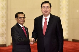 Maldives' parliamentary speaker Abdulla Maseeh (L) meets with Zhang Dejiang, Chairman of the Standing Committee of the National People's Congress of China. PHOTO/XINHUA
