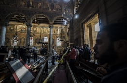 The blast killed at least 25 worshippers during Sunday mass inside the Cairo church near the seat of the Coptic pope who heads Egypt's Christian minority, state media said. / AFP PHOTO / KHALED DESOUKI