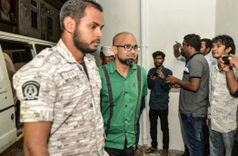 MMPRC's former Managing Director Abdulla Ziyath escorted after a hearing. MIHAARU PHOTO