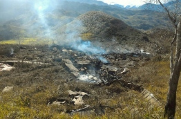 Amilitary plane crashed on December 18 in remote mountainous region of Indonesia's Papua, killing 13 people on board, military and police officials said. / AFP PHOTO / SEARCH AND RESCUE TEAM / HANDOUT