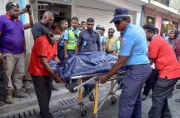 Police wheels out remains of couple discovered dead together in capital Male to be taken to IGMH. PHOTO: NISHAN ALI/MIHAARU