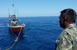 Captain Jamshad Mohamed of MCGS Huravee looks on as the ship tows the Sri Lankan fishing vessel. PHOTO/MNDF
