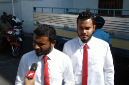 Raajje TV journalists Mohamed Visam (L) and Leevan Ali Nazeer speak to reporters after Criminal Court reads their final verdict. PHOTO: MOHAMED HAMDHOON/MIHAARU