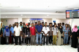 MPL CEO Mohamed Junaid pose with some people with special needs after they arrive at Velana International Airport to attend the ceremony awarding them jobs at MPL branches. PHOTO/MPL