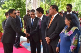 President Yameen (L) greets Parliament Majority Leader Ahmed Nihan outside Dharubaaruge prior to his Presidential Address to open the first sitting of 2017's parliament sessions. PHOTO/PRESIDENT'S OFFICE