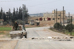 Turkish troops backed by Syrian rebel fighters have entered the centre of the Islamic State group bastion of Al-Bab and will soon capture it, President Recep Tayyip Erdogan said Sunday. / AFP PHOTO / Rafat AHMAD