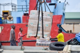 Goods being loaded into a boat at Male Commercial Harbour. PHOTO: NISHAN ALI/MIHAARU