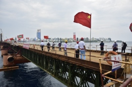 Journalists and reporters milling on the China-Maldives Friendship Bridge under development between capital Male and airport island Hulhule. PHOTO/HUSSAIN WAHEED/MIHAARU