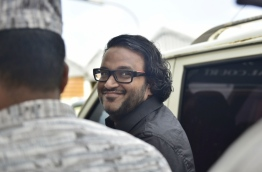 Former Vice President Adheeb escorted out of the Criminal Court. PHOTO: HUSSAIN WAHEED/MIHAARU