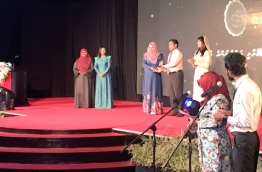 President Yameen handing over 'Rehendhi Award', given to women in appreciation of their work, at the celebration of International Women's Day 2017. PHOTO/Social Media