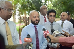 MP Faris speaks to reporters after submitting a motion of no confidence against parliament speaker Abdulla Maseeh. PHOTO: HUSSAIN WAHEED/MIHAARU