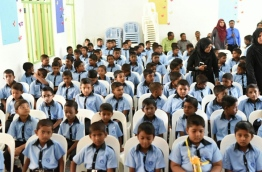 School children pictured seated in a hall: schools and universities have been closed over the spread of swine flu in Maldives. PHOTO/EDUCATION MINISTRY
