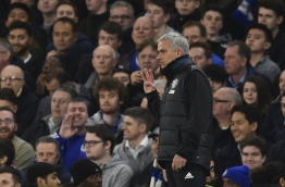 Manchester United's Portuguese manager Jose Mourinho gestures with three fingers on the touchline during the English FA Cup quarter final football match between Chelsea and Manchester United at Stamford Bridge in London on March 13, 2017. / AFP PHOTO / Glyn KIRK / RESTRICTED TO EDITORIAL USE. No use with unauthorized audio, video, data, fixture lists, club/league logos or 'live' services. Online in-match use limited to 75 images, no video emulation. No use in betting, games or single club/league/player publications. /
