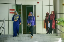 Some civil servants pictured at the entrance to the main government office complex 'Velaanaage' in the capital Male. MIHAARU PHOTO/NISHAN ALI