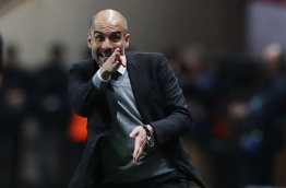 Manchester City's Spanish manager Pep Guardiola reacts during the UEFA Champions League round of 16 football match between Monaco and Manchester City at the Stade Louis II in Monaco on March 15, 2017. / AFP PHOTO / Valery HACHE