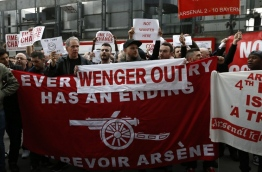 Arsenal supporters calling for the end of the reign of Arsenal's French manager Arsene Wenger, arrive at the stadium with their placards ahead of the English FA cup quarter final football match between Arsenal and Lincoln City at The Emirates Stadium in London on March 11, 2017. / AFP PHOTO / Ian KINGTON / RESTRICTED TO EDITORIAL USE. No use with unauthorized audio, video, data, fixture lists, club/league logos or 'live' services. Online in-match use limited to 75 images, no video emulation. No use in betting, games or single club/league/player publications. /