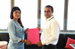 MATATO Deputy Secretary General Asra Naseem (L) and Everything Red CEO Mohamed Rifau sign agreement tasking Everything Red to develop web platform to promote MATATO's activities and events. PHOTO/MATATO