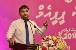 Dhangethi MP Ilham Ahmed speaks at PPM ceremony to present membership forms of ruling party's new members. PHOTO: HUSSAIN WAHEED/MIHAARU