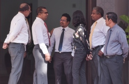 Lawmakers pictured outside the parliament ahead of a debate. PHOTO: HUSSAIN WAHEED/MIHAARU