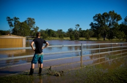 Rising floods continued to plague parts of eastern Australia as emergency workers battled to restore water and electricity in cyclone-hit areas on April 2, with the recovery efforts expected to last several months. / AFP PHOTO / Patrick HAMILTON