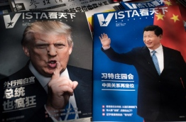 """The first summit between US President Donald Trump and his Chinese counterpart Xi Jinping will be of """"great significance"""" for global peace, the two countries' top diplomats agreed ahead of the meeting. The two are to meet at Trump's Mar-a-Largo resort in Florida on April 6 and 7, as the two global powers look to smooth sometimes spiky relations. / AFP PHOTO / NICOLAS ASFOURI"""