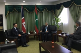 British Ambassador James Dauris (L) in a meeting with Minister of Foreign Affairs Mohamed Asim